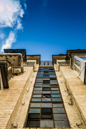 tatty: An old building with broken window glass and crumbling balconies Stock Photo