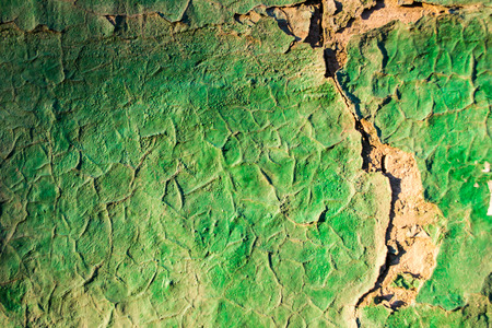 entropy: Green painted brickwork begns to flake due to age
