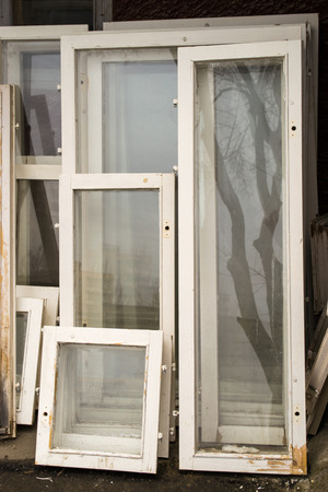 intact: Unwanted window frames with white wood and intact glass