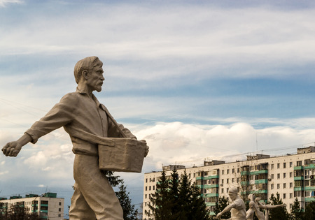 figuring: Stone man walking forward casting seeds towards the sky Stock Photo