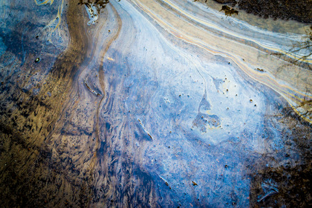 Leaking oil creates multicolored trails on seawater with marble water wash Stok Fotoğraf