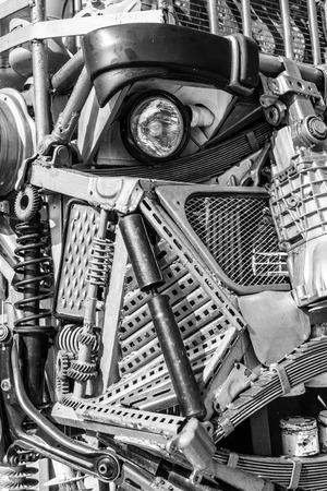 Welded: Closeup of scrap metal welded to create a human robot art work Stock Photo
