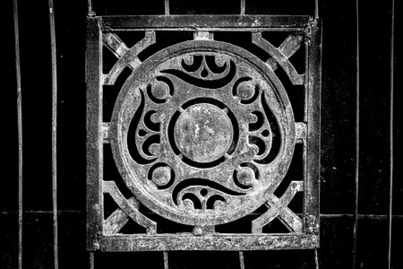 cast iron: Dark cast Iron metal decoration from the soviet era of residential and social planning