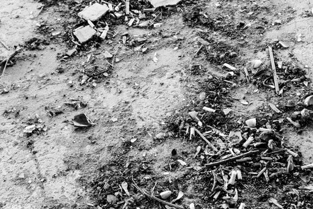 entropy: Dusty and dirty concrete floor with old cigarette butts and rubble
