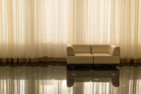 sleek: Sleek modern furniture set against a large curtain