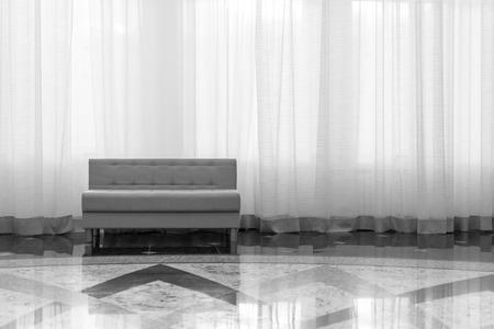 sleek: Sleek modern furniture set against a large curtain in black and white
