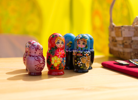 matrioska: Brightly decorated Russian puzzle dolls displayed in a decorative row