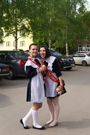 highschool: Two Russian schoolgirls in Uniform celebrating graduation from Highschool in Ufa May 2015