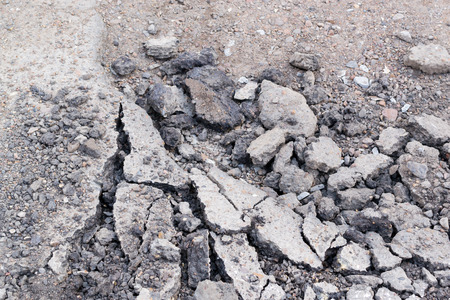 blacktop: Broken asphalt on a street damaged from weather and vehicles Stock Photo