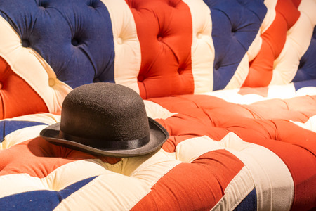 Union Jack Flag style modern cushioned sofa with black felt bowler hat