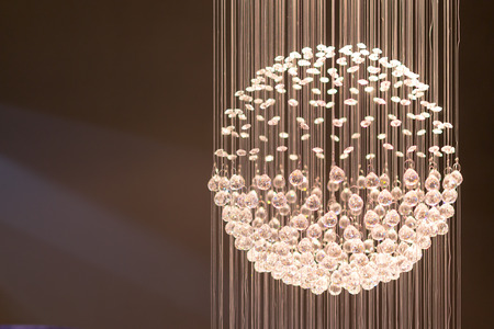 Single crystal light display with shards of illuminated string