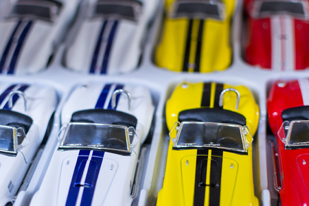 luxury goods: Modern plastic cars in a row in Ufa Russia waiting for shoppers to buy the luxury goods Stock Photo