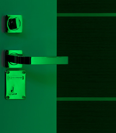 nickle: Green neon style door handle in chrome with lock and latch Stock Photo