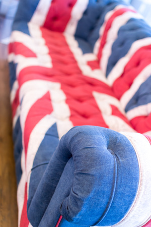 confortable: Single Union Jack British flag colored home sofa Stock Photo