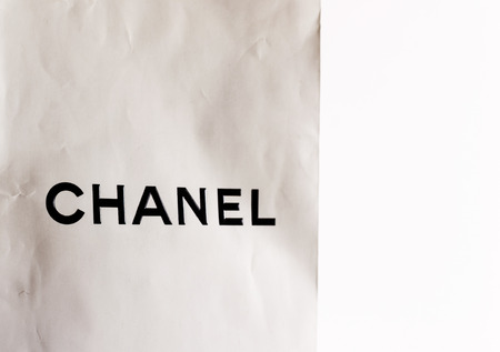 Used Chanel paper shopping bag with creases and wear