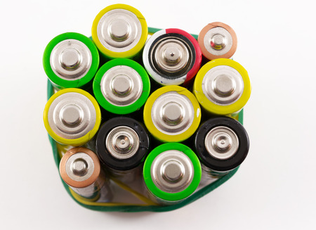 bunched: Bunched together AA Batteries in closeup on white
