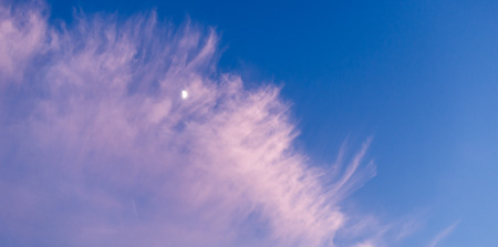 wisps: Wisps of cloud at sunset and a half moon