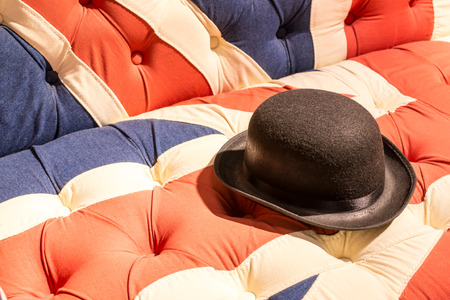 confortable: Union Jack Flag style modern cushioned sofa with black felt bowler hat