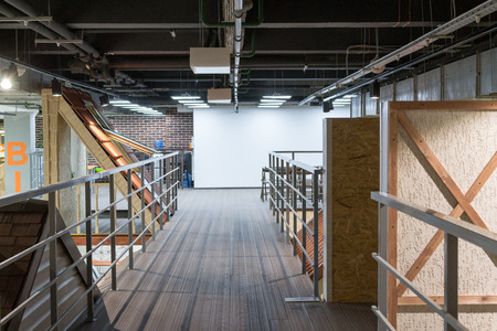 planned: Wooden loft interior with decking and fluorescent lights