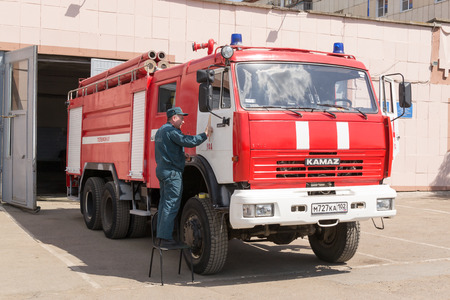 redecorating: Fireman in Ufa Russian redecorating a fire vehicle in the summer heat of May 2015 Editorial