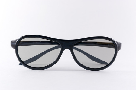 stereoscope: Clean folded black 3D glasses isolated on a white background Stock Photo