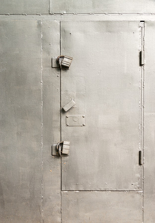strongly: Silver painted strongly double locked and secure metal door Stock Photo