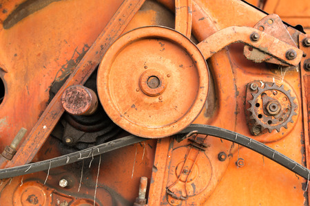 dirty teeth: Closeup of rusty cogs and gears of a disused USSR Soviet combine harvester