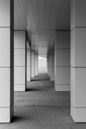 diminishing perspective: Modern style building blocks supported with diminishing perspective in black and white Stock Photo