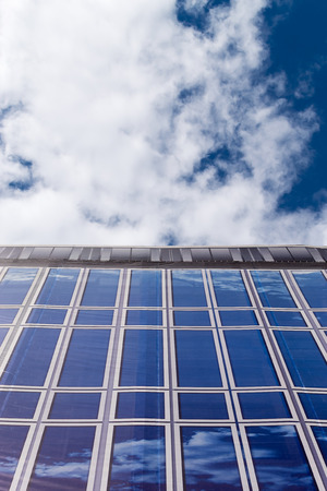 concealment: Blue and White sky external disguise covering an ugly building Stock Photo