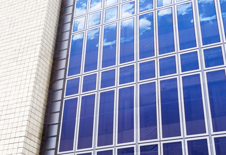 building external: Blue and White sky external disguise covering an ugly building Stock Photo