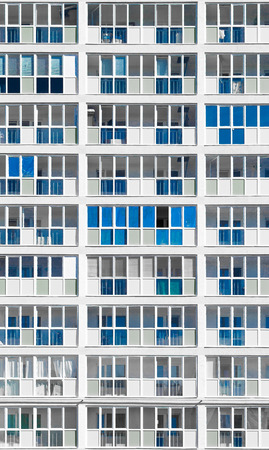 unsaturated: Modern housing apartments in unsaturated color and highlighted blue exterior decoration