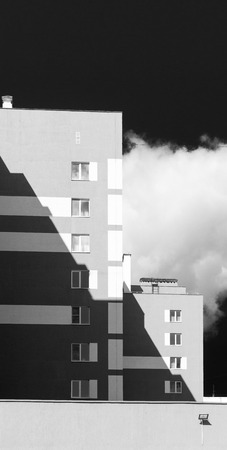 housing style: Monochrome style modern housing apartments with shadow area and dark sky
