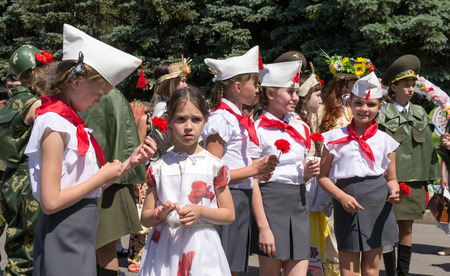 Line of young girls in traditional Red Army Uniforms and Communist Pioneer uniforms as part of the Russia Day celebrations in Ufa Bashkortostan