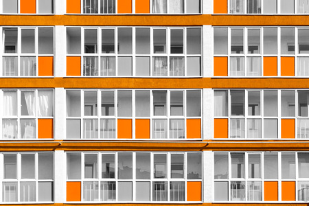 unsaturated: Futuristic housing apartments with unsaturated colours with highlighted orange paint exterior decoration Stock Photo