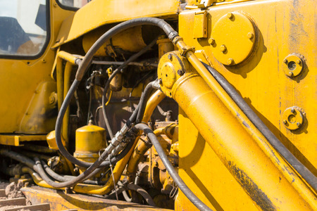 engine compartment: Close-up of a engine compartment of a yellow industrial earth excavator machine