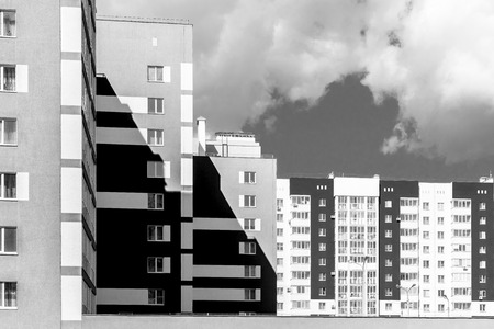 housing style: Monochrome style modern public housing apartment buildings with shadow area and dark sky