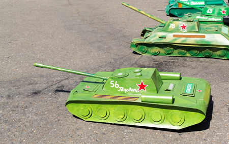 remote controlled: Line of remote controlled Russian World War II tanks on tarmac