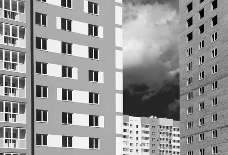 public housing: Monochrome style newly built modern public housing and homes under construction with shadow areas and dark sky Stock Photo