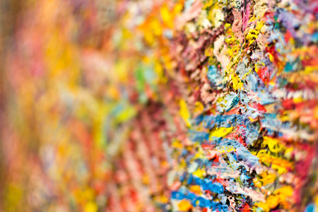 verb: Multicolored Brush Strokes on Canvas in Closeup