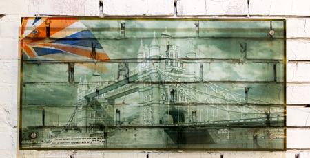 Famous landmark Tower Bridge in London with bright union jack flag photo