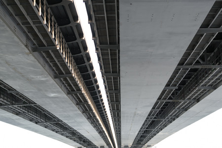 famous industries: Underneath view and detail of a metal road bridge and sunlight