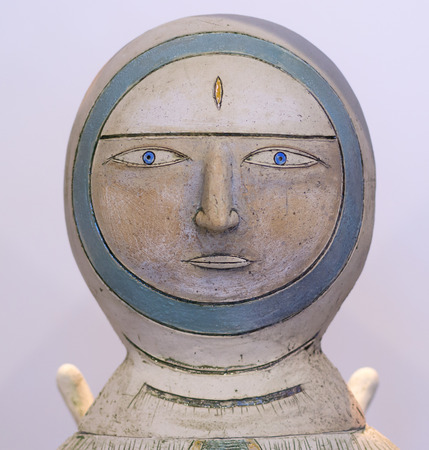 sculpture: Single painted astronaut sculpture in white stone