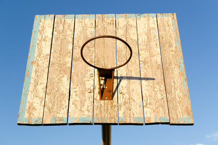 backboard: Rusty metal basketball hoop and backboard against a blue sky Stock Photo