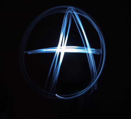 anarchism: Single Anarchy sign painted in blue light in the darkness