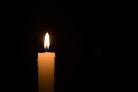 burning time: Single white candle burning at night time Stock Photo