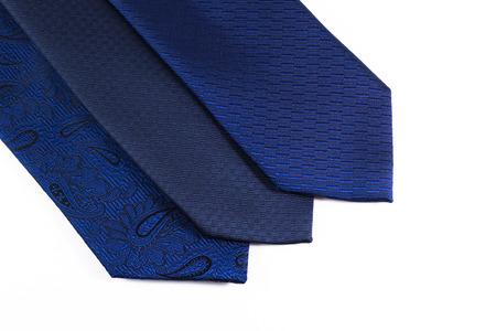 unworn: Three blue silk ties in a row belonging to a modern business man on a white background