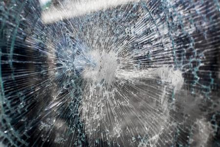 broken glass window: Broken glass window of a local vending machine at a train station