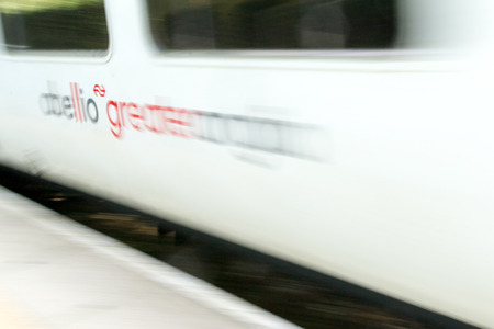 rushes: Abellio Greater Anglia train rushes past a station in Chelmsford, Essex in August 2015 carrying commuters to work in London