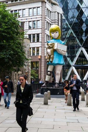 britan: August 18th 2015 - Damien Hirst 22 foot bronze art installation titled Charity on display in London as part of Sculpture in the City during the August 2015 exhibition Editorial