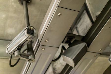 public address: Closeup of a fixed metallic colored CCTV camera and public address system Stock Photo